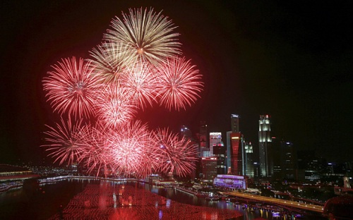 Fireworks explode in Marina Bay against the skyline of Singapore during New Year's Day celebrations